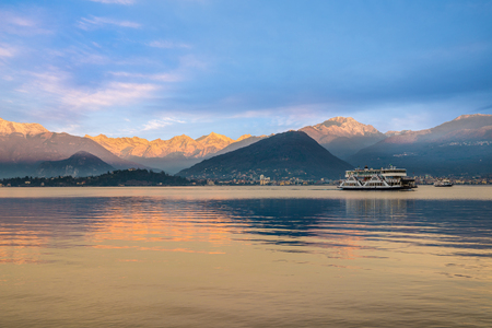 Lake Maggiore, Laveno, Italy. Sunrise over the snow-covered Alps. In the background the Piedmont side with the small town of Verbania and Intra