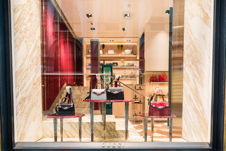 Milan, Italy - February 17, 2017: Gucci shop at the Gallery Vittorio Emanuele II (Piazza Duomo) in Milan center. Made in Italy. Symbol and concept of luxury, shopping, wealth and elegance