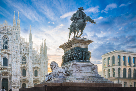 Piazza del Duomo, Milan, Italy. Equestrian monument to king Vittorio Emmanuele II at dawn. In the background the cathedral of Milan Editorial