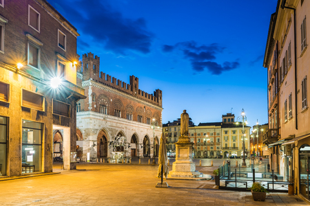 Piacenza, medieval town, Italy. Piazza Cavalli (Square horses) and palazzo Gotico (Gothic palace) in the city center on a beautiful day, at dusk. Emilia Romagna
