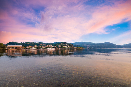 Lake Maggiore, colorful sky, northern Italy. Enchanting view of the city of Arona, province of Novara, Piedmont side of Lake Maggiore Stock Photo
