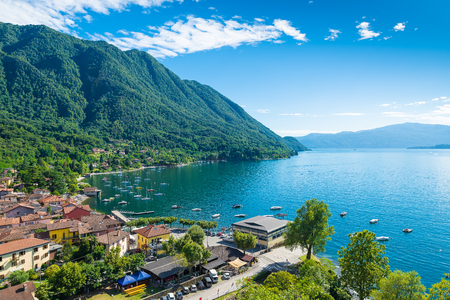 Lake Maggiore, Verbano, Caldè, Italy. One of the most charming corners of the lake Maggiore on a beautiful summer day. Aerial view of the small town, hamlet of Castelveccana, and of the small harbor Reklamní fotografie