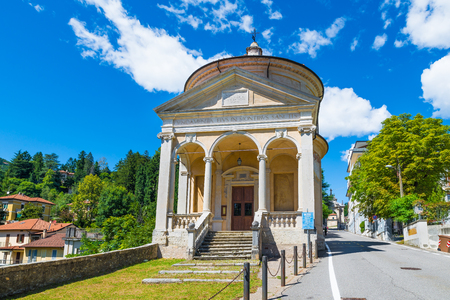 Sacro Monte of Varese (Santa Maria del Monte), Italy, starting point for the Via Sacra with 14 chapels that leads to medieval village. In the foreground the Immaculate church on a beautiful summer day Editorial
