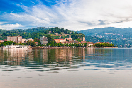 Lake Maggiore, Arona, Italy. Tourist town on Lake Maggiore, Piedmont shore. It is visible the rocky area with the public park and the ruins of the rocca (fortress) Borromea of Arona