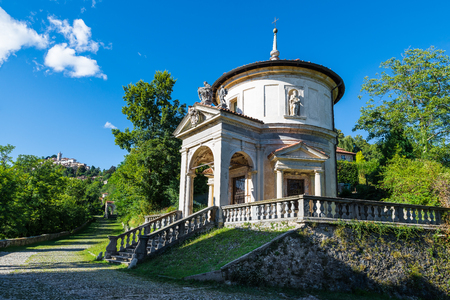 Sacro Monte of Varese (Santa Maria del Monte), Italy. Via Sacra that leads to medieval village, with the seventh chapel. In the background the village of Sacro Monte. World Heritage Site - Unesco Stock Photo