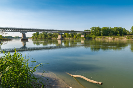 Po river at the medieval town of Piacenza, Italy. Car bridge that leads to the city. The Po River is the longest Italian river and one of the largest rivers in Europe
