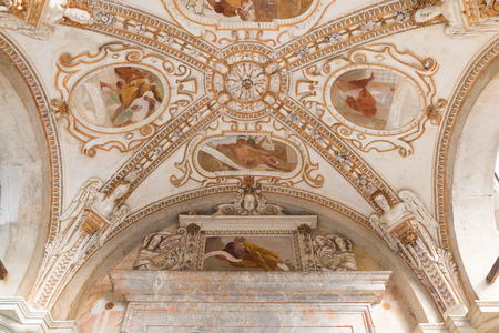 Sacro Monte of Varese (Santa Maria del Monte), Italy. Old fresco (17th century) on the external vault of the seventh chapel along holy road that leads to medieval village.