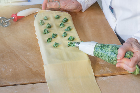 Italian pasta, preparation of tortelli with spinach and ricotta