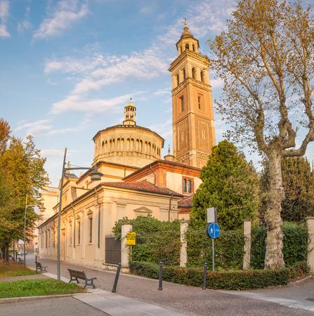 Sanctuary Beata Vergine dei Miracoli (on yellow sign: Sanctuary Blessed Virgin of the Miracles 16th century) , Saronno, Italy; declared European Heritage. View from street Santuario, at sunrise