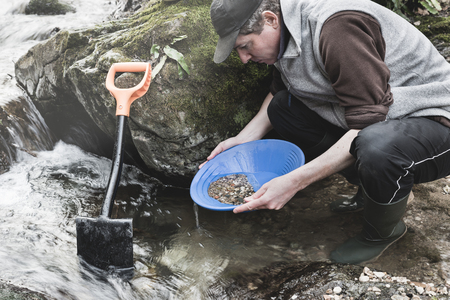 Adventures on river. Gold panning