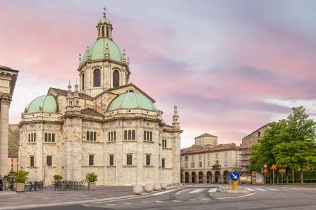 Historic center of Como city with the Santa Maria Assunta cathedral also known as the Duomo of Como seen from square Giuseppe Verdi, Italy