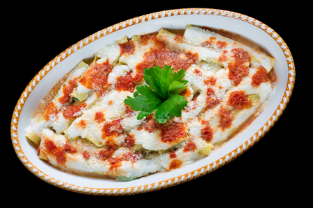 Cannelloni with spinach, ricotta, tomato sauce, bechamel and cheese