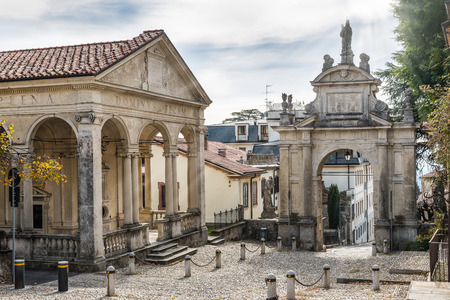 Sacro Monte of Varese (Santa Maria del Monte), Italy. Sacred way that leads to medieval village at the beginning of the climb of the the Via Crucis. First chapel and first arch. Unesco site