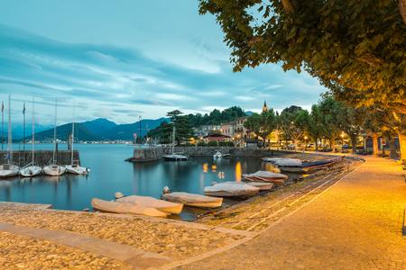 Big Italian lake at dawn. Lake Maggiore and Laveno with its small port Zdjęcie Seryjne
