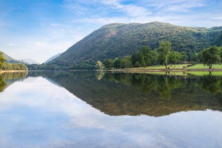 Beautiful natural Italian lake. Lake Ghirla, near the most known and big lakes Maggiore and Lugano in the province of Varese, not far from Milan. Frequented in the summer for the fresh climate