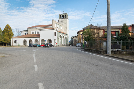 Castelnovate, Italy. Small town on the banks of the Ticino river, province of Varese, Lombardy. Square S. Stefano with the village church