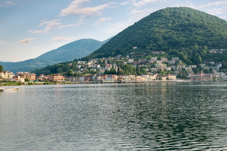 Lake Lugano with the customs bridge between Lavena Ponte Tresa on the left in Italy and Ponte Tresa on the right in Switzerland. Border between Italy and Switzerland