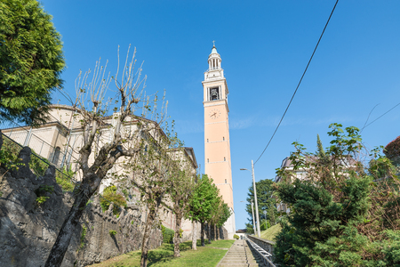 Malnate, province of Varese, Italy. Church San Martino, the main church of the small town of Malnate. Flight of steps leading from the church entrance in square San Martino to the cemetery