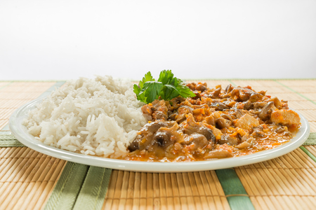 Pork meat. Stew of pork (loin) with honey mushrooms and rice basmati