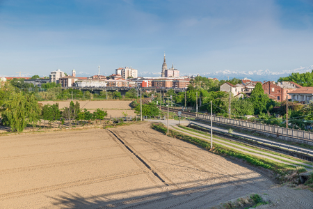 The city of Novara with the snow capped Alps in the background. The bell tower of the Cathedral of Novara and the characteristic 121 meter high dome of the Basilica of San Gaudenzio are visible