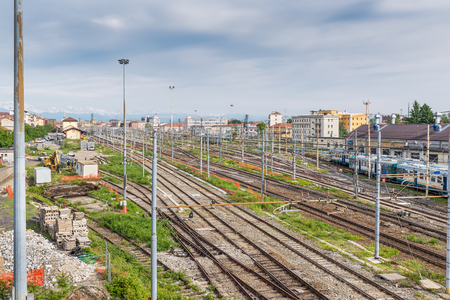 Novara train station with snow capped Alps in the background, Italy