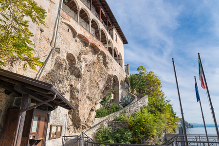 Lake Maggiore, Italy. Eremo di  Santa Caterina del Sasso (Hermitage of Saint Catherine of stone) from the arrival area of the boats. It is one of the most fascinating historical sites of the lake