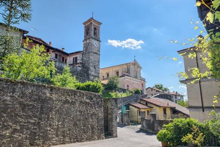Historic center of Azzio, village in north Italy on the edge of the Campo dei Fiori regional park, province of Varese. Parish Beata Vergine Annunziata di Azzio of 1400, enlarged in 1749, street Cavour