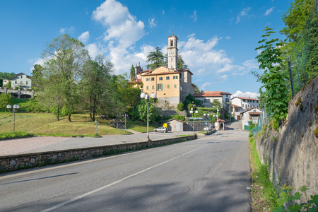 Municipality within a protected area in northern Italy. Castello Cabiaglio and Campo dei Fiori regional park, province of Varese. In the photo the town and the church of St. Appiano Zdjęcie Seryjne
