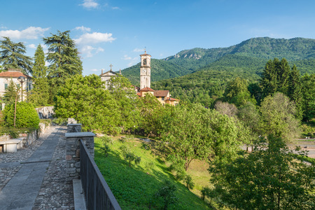 Church in mountain. Picturesque view of a protected area, north Italy, Campo dei Fiori regional park and Castello Cabiaglio village - Varese, Lombardy. In the photo the the church of St. Appiano Zdjęcie Seryjne