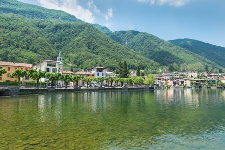 Tourist town on the lake of Lugano; Riva San Vitale in summer, Switzerland, at the foot of Monte San Giorgio. Monte San Giorgio is a UNESCO site for the important fossiliferous deposits
