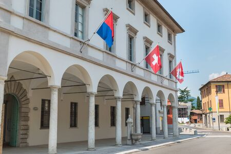 Historic center of Riva San Vitale with the town hall, Switzerland. Tourist town on Lake Lugano at the foot of Monte San Giorgio, UNESCO site for the important fossiliferous deposits