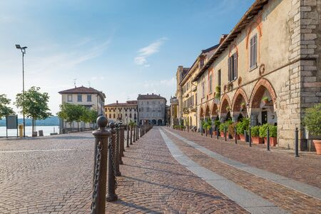 Picturesque town on lake. Historic center of Arona, lake Maggiore, Italy. View of the piazza del Popolo, the oldest and most characteristic part of the village of Arona, province of Novara, Piedmont