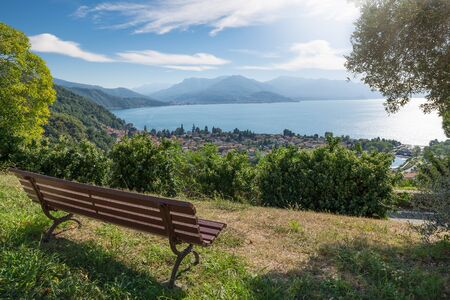 Big Italian lake. Lake Maggiore with the town of Maccagno, in the background the town of Luino. Amazing summer landscape