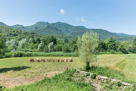 Green fields and blue sky. Picturesque view of a protected area in northern Italy. Campo dei Fiori regional park seen from the village of brinzio, province of Varese, Lombardy