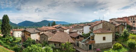 Picturesque village in northern Italy. Valmarchirolo and Cugliate Fabiasco, province of Varese. To the left, in the background, is visible the Valganna