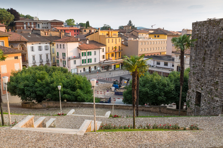 urbanization works in the historic center of a Swiss city. Mendrisio, square del Ponte in front of the church of Santi Cosma e Damiano at sunset