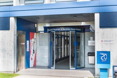 Mendrisio, Switzerland  – June 4, 2019: Main entrance to the Mendrisio Regional Hospital Blessed Virgin (Ospedale Regionale di Mendrisio Beata Vergine, as written on the door)