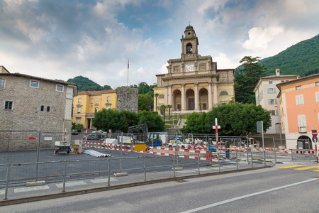 Urbanization works in the historic center of a Swiss city. Mendrisio and in the background the church of Santi Cosma e Damiano, square del Ponte