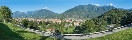 Domodossola, important city in northern Italy. View towards the Val Vigezzo (Vigezzo Valley). To the right is visible the hill with the Sacred Mount Calvary of Domodossola, UNESCO site Banco de Imagens