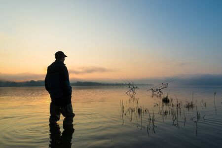 Fishing adventures, carp fishing at sunset. Active lifestyle concept
