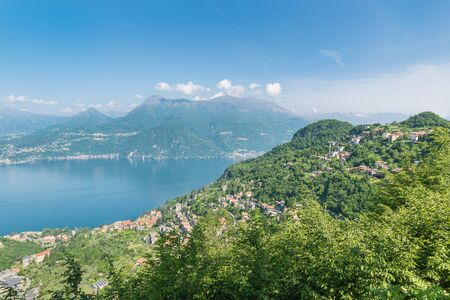 Large European lake seen from above. Lake Como, Italy with the village of Varenna at the bottom and the village of Perledo on the hill. Panorama from the road to Esino Lario Reklamní fotografie