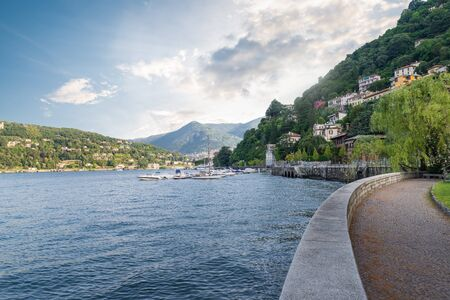 Big european lake. Beautiful and famous lake Como from the lakeside promenade in the city of Como, northern Italy