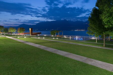 Lakeside promenade at dusk. Luino lakefront on Lake Maggiore, Italy