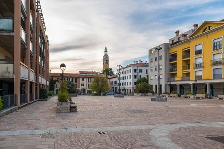 Typical town center with stone pavement in northern Italy. The town of Malnate located in the Lombardy region Reklamní fotografie