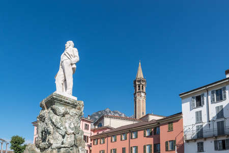 Lecco, lake Como, Italy - October 5, 2019: Historic center of Lecco. Square Cermenati with the monument to Cermenati and the bell tower of San Nicolò Lecco, one of the symbols of the city