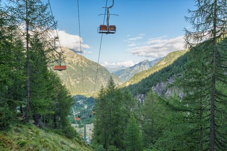 Chair lift on the european alps in summer. Vacation and hiking concept. Macugnaga and the Anzasca valley view from the Belvedere , Piedmont, Italy Reklamní fotografie