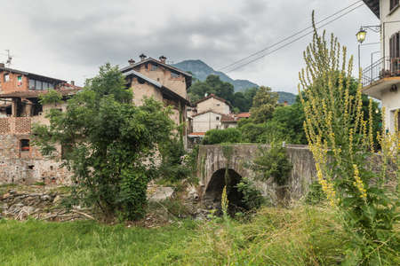Traditional small town with bridge and old houses. Rancio Valcuvia village in northern Italy in the Campo dei Fiori regional park, province of Varese