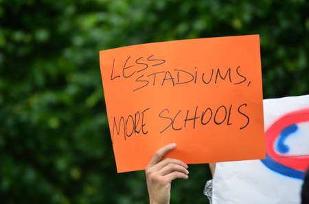Less Stadiums, More Schools Handwritten Sign of Protest