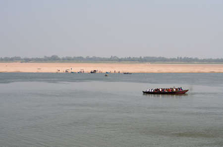Boat Crossing the Ganges River in Varanasi, India Stock Photo