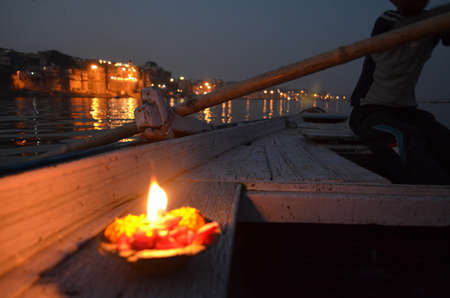 Lit Candle on a Boat at Night in The Ganges River in Varanasi, India